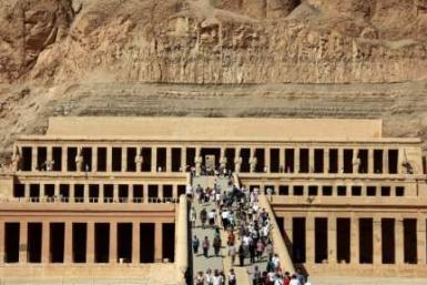 Tourists walk on the stairs leading to Queen Hatshepsut Temple in Luxor, southern Egypt, November 9, 2009.