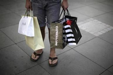 A man carries shopping bags in Santa Monica, California, October 11, 2010.