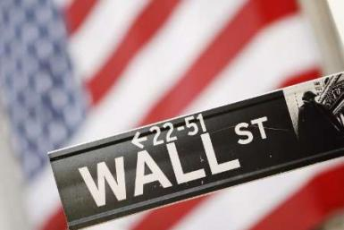The Wall Street sign is seen outside the New York Stock Exchange