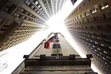 A flag flies on outside of the New York Stock Exchange building in New York in this May 6, 2010 file photo.