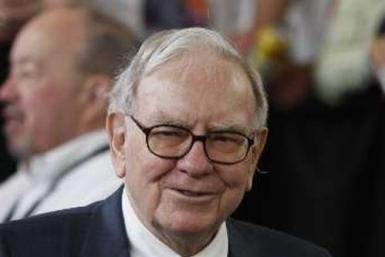 Buffett backed China car maker scraps dividend; profit dives