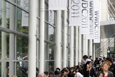 Attendees eat outside the Moscone West Convention Center following the keynote address at the Apple Worldwide Developers Conference in San Francisco