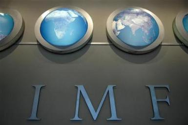 IMF nameplate is displayed on a wall at the headquarters during the World Bank/International Monetary Fund Spring Meetings in Washington