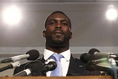 NFL football star Michael Vick of the Philadelphia Eagles speaks on behalf of the Humane Society in Washington