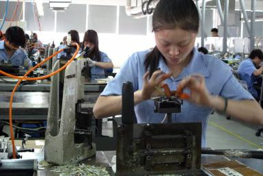 Workers at Amphenol factory weave intricate cables for western brands in China's Guangzhou