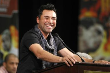 Boxing promoter De La Hoya smiles during a news conference at the MGM Grand Resort in Las Vegas