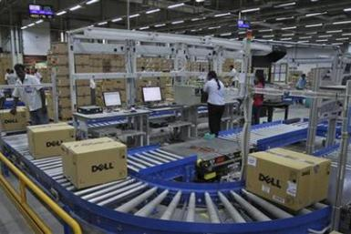 Computers packed into boxes are transported on a conveyor belt at a Dell factory in Sriperumbudur Taluk, in the Kancheepuram district of the southern Indian state of Tamil Nadu, June 2, 2011.
