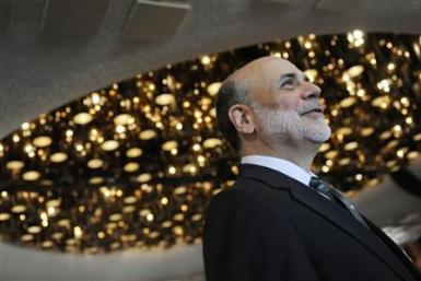 Federal Reserve Chairman Ben Bernanke arrives to speak at a conference on systemic risk, at the Federal Reserve in Washington