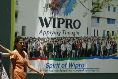People walk in the Wipro campus in Bangalore June 23, 2009. Goldman Sachs counts the lack of quality education as one of the 10 factors holding India back from rapid economic growth.