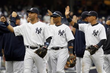 Yankees players Jeter Cano and Rodriguez celebrate after the Yankees defeated Tampa Bay Rays in their MLB American League baseball game in New York
