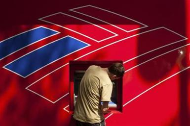 A Bank of America customer uses a Bank of America ATM