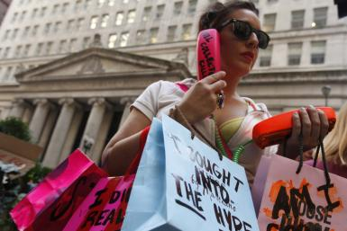 A protestor demonstrates in support of the New York Occupy Wall Street protests in the financial district of Chicago