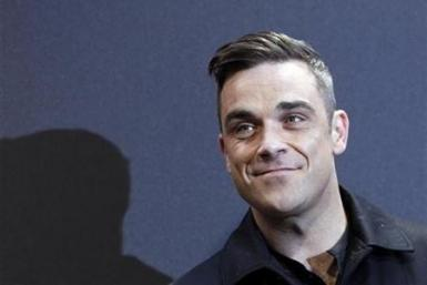 British singer Robbie Williams arrives on the red carpet for the German premiere of ''Cars 2'' in Munich