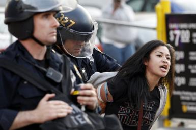 A woman is arrested during an anti-Wall Street protest in Oakland, California