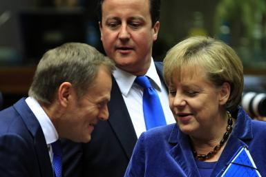 Poland's Prime Minister Tusk Britain's Prime Minister Cameron and Germany's Chancellor Merkel attend an European Union summit