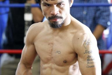 Congressman and boxer Manny Pacquiao of the Philippines poses during a media workout at Wild Card Boxing Club in Los Angeles