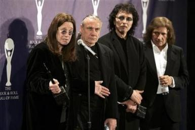 Members of Black Sabbath band Ozzy Osbourne, Bill Ward, Tony Iommi and Geezer Butler (L-R) pose backstage at the Rock and Roll Hall of Fame induction ceremony at the Waldorf Astoria Hotel in New York March 13, 2006.