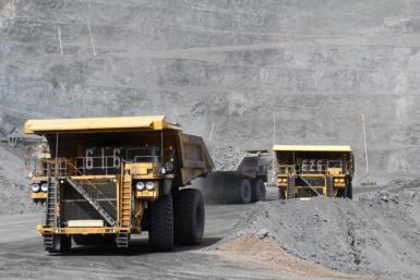 Trucks haul ore at Barrick Gold project