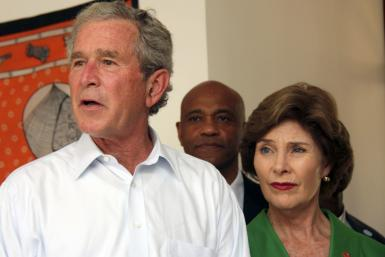 George W. Bush and Laura Bush arrive at Mnazi Mmoja Hospital to see the government efforts in the prevention of transmission of HIV/AIDS in Tanzania's capital Dar es Salaam