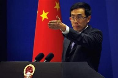 China's Foreign Ministry spokesman Liu Weimin gestures to a journalist during a news conference in Beijing November 21, 2011.