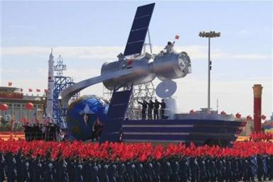 A float with a model featuring satellite is displayed during a parade to mark the 60th anniversary of the founding of the People's Republic of China, in Beijing October 1, 2009.