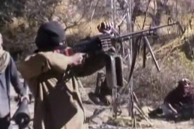 Still image taken from a video shows a Pakistani Taliban fighter firing a weapon as he receives training in Ladda, South Waziristan tribal region