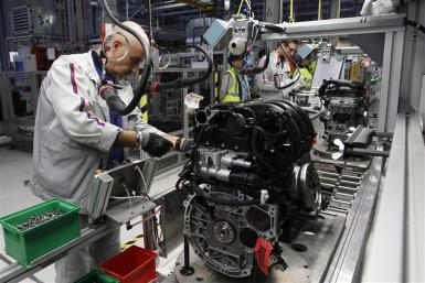 "Employees of French carmaker PSA Peugeot Citroen work on the new engine ""EB"" assembly line at the company engines factory in Tremery near Metz"