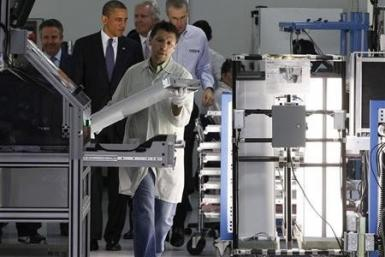 U.S. President Barack Obama (2nd L) tours a North Carolina manufacturing facility of energy efficient LED lights, Cree Inc., in Raleigh-Durham, June 13, 2011.