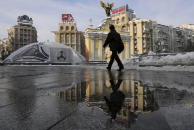 A man walks in Maidan square in Kiev, Ukraine