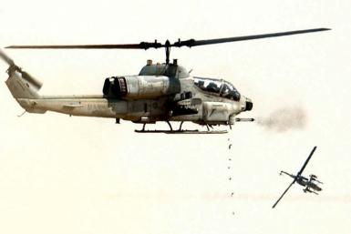 MARINE SUPER COBRA HELICOPTERS FIRE AT TARGETS.
