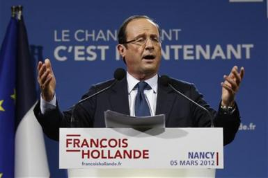 Hollande, Socialist Party candidate for the 2012 French presidential election, delivers a speech during campaign rally in Nancy