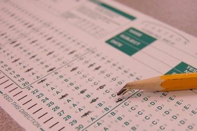 The College Board, which runs the SAT and the ACT test companies, will introduce these worldwide initiatives and others later on Tuesday in the wake of a massive cheating scheme in New York involving 20 current and former high school students.