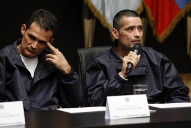 Policemen Jorge Trujillo Solarte and Carlos Jose Duarte, who were part of group of hostages freed after being held for more than a decade by FARC rebels, attend a news conference in Bogota
