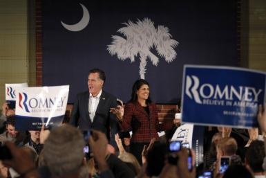 Republican presidential candidate Romney is introduced by South Carolina Governor Haley during a political rally at the Hall at Senate's End in Columbia