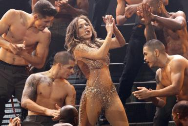"Jennifer Lopez and Casper Smart have been seen getting hot and heavy on beaches and streets, but nothing compares to Lopez's new video for her song, ""Dance Again."""