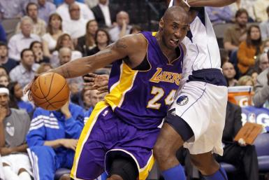 Lamar Odom guards Kobe Bryant during a game on Wednesday. Could the pair be reunited next season?