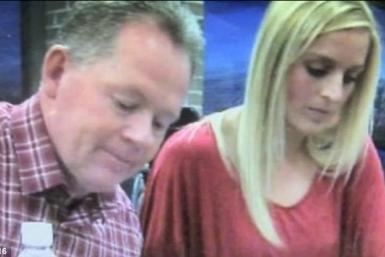 Dorrell sits beside Petrino at a signing event last week.