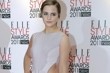 British actress Emma Watson poses for photographers as she arrives for the Elle Style Awards in London