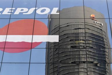 The Sacyr Vallehermoso Tower is reflected on the Repsol office building in Madrid
