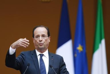French President Francois Hollande gestures during a news conference with Italian Prime Minister Mario Monti at the Chigi palace in Rome