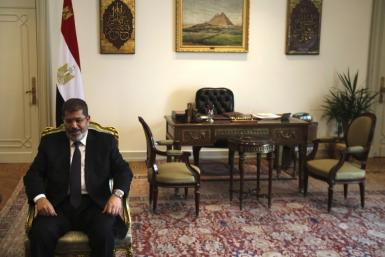 Egyptian President Mohammed Mursi seated
