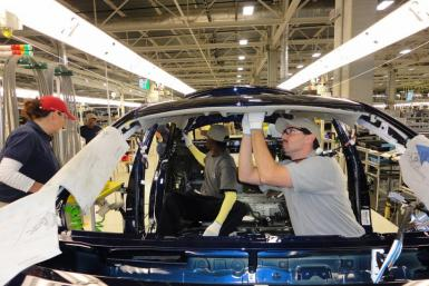 Toyota workers assemble the 2012 Corolla at the Blue Springs, Miss., plant, which began hiring 2,000 employees in 2011.