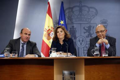Spanish government ministers announce the 2013 budget in a news conference Thursday.
