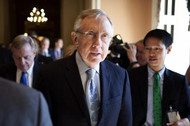 Harry Reid speaks with reporters after meeting with House Democratic leadership on the debt ceiling crises on Capitol Hill in Washington