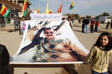 Kurdish carry banner of Ocalan