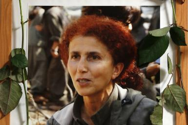 A portait of late PKK activist Sakine Cansiz is seen at the Kurdish cultural centre in Paris.