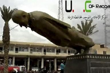 Assad statue torn down