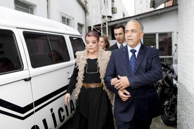 Doctor Virginia Soares de Souza (L) walks with her lawyer as they leave the police station in Curitiba