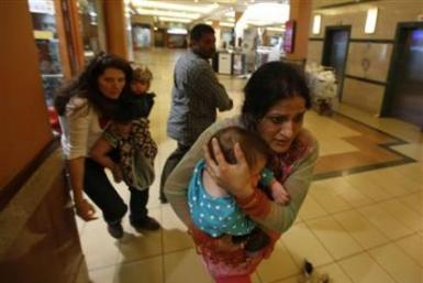 Indian woman holds her baby during attack at Westgate mall