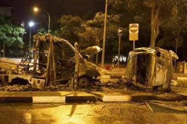 Cars burnt after riot in Little India, Singapore.